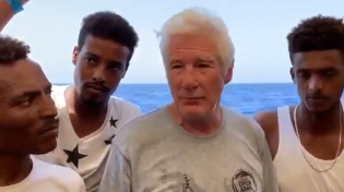 Thumbnail for Pedollywood millionaire Richard Gere boards migrant ship stuck in the Mediterranean and actively encourage illegal migration to Europe.